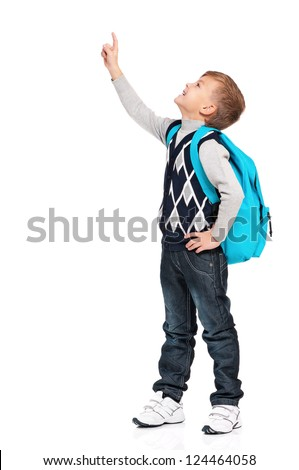 Portrait of happy boy with backpack showing something isolated on white background