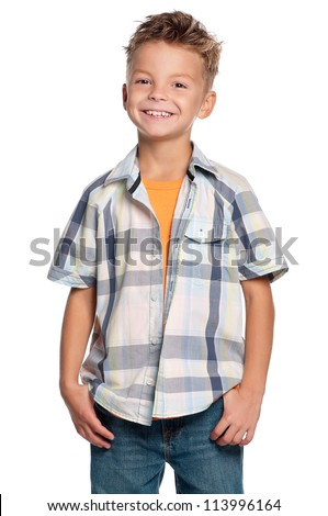 Portrait of happy boy with hands in pockets isolated on white background - stock photo