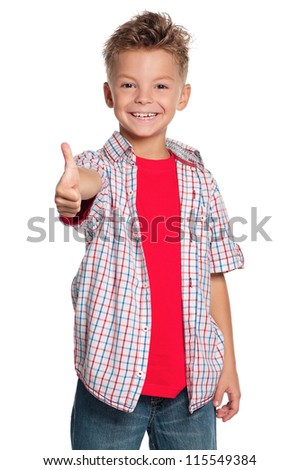 Portrait of happy boy with thumb up isolated on white background