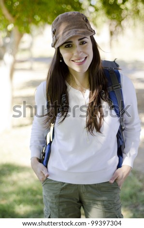 Portrait of happy brunette smiling on a hiking trip