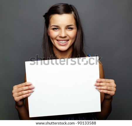 Portrait of happy brunette with advert looking at camera
