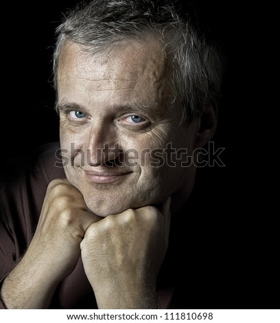portrait of happy business man od dark background