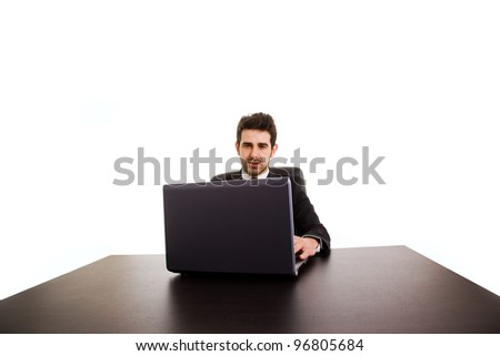 Portrait of happy business man with laptop at office desk