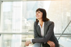 Portrait of happy business woman looking confident