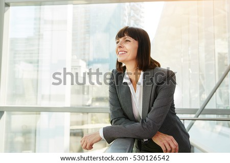 Portrait of happy business woman looking confident #530126542