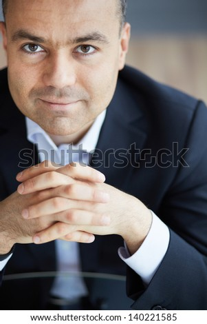 Portrait of happy businessman looking at camera - stock photo