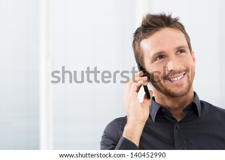 Portrait Of Happy Businessman On The phone