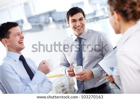 Portrait of happy businessmen with cups laughing