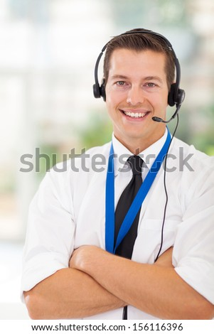 portrait of happy call center customer service worker with arms crossed