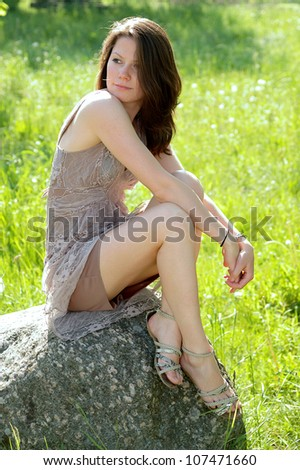 Portrait of happy cheerful smiling young beautiful woman, outdoors