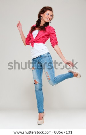 portrait of happy cheerful woman over grey background