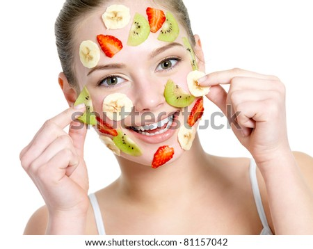 Stock Photo Portrait of happy cheerful young beautiful woman with fruit facial mask - isolated on white
