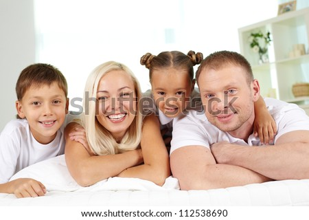 Portrait of happy children and their parents at home