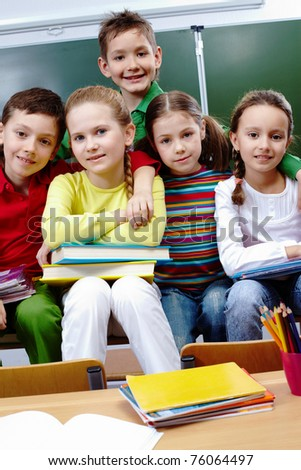 Portrait of happy children looking at camera in class