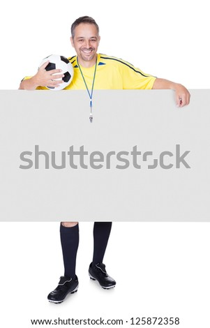 Portrait Of Happy Coach Holding Placard And Football Isolated On White Background