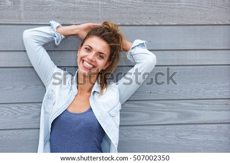 Portrait of happy confident woman standing with hands behind head #507002350