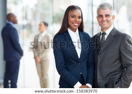 portrait of happy corporate colleagues in modern office