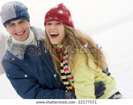 Portrait of happy couple having a fun in the forest