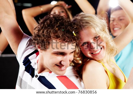 Portrait of happy couple having fun in a night club