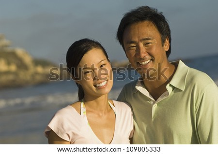 Portrait of happy couple on beach vacation