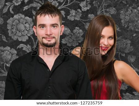Portrait Of Happy Couple On Wallpaper, Indoors