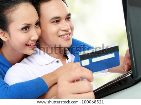 portrait of happy couple shopping online at house