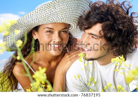 Portrait of happy couple spending time outside