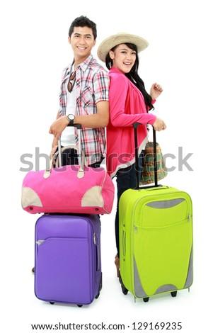 portrait of happy couple tourist bring suitcase and smile