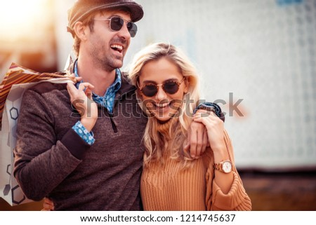 Portrait of happy couple with shopping bags after shopping in the city. #1214745637