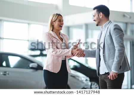 Portrait of happy customer buying new car Foto stock ©