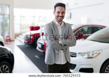 Portrait of happy customer buying new car Stock photo ©