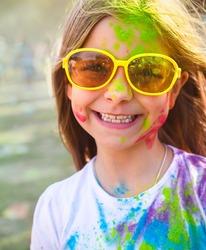 Portrait of happy cute litttle girl on holi color festival