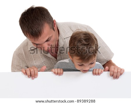 Portrait of happy dad and son with empty white board isolated on white background