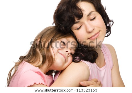 Portrait of happy daughter enjoying a piggyback ride on mothers back, isolated over white