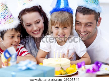 Portrait of happy family celebrating a birthday at home