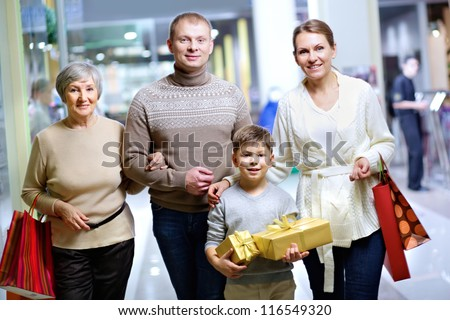 Portrait of happy family during shopping in the mall before Christmas