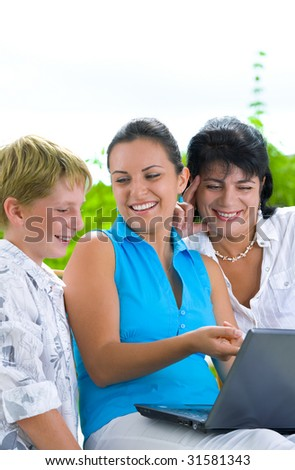Portrait of happy family getting busy with laptop