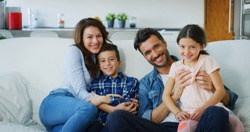 Portrait of happy family having fun in living room. Concept of happy family, childhood, parenthood