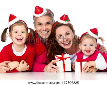 Portrait of happy family in Christmas hat on white background