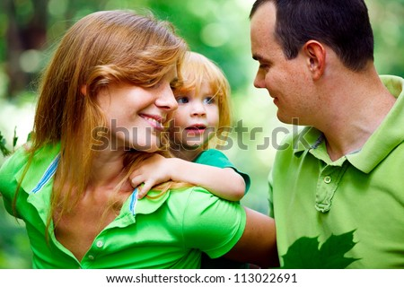 Portrait of Happy Family In Park - outdoor shot