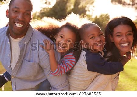 Portrait Of Happy Family In Summer Garden #627683585