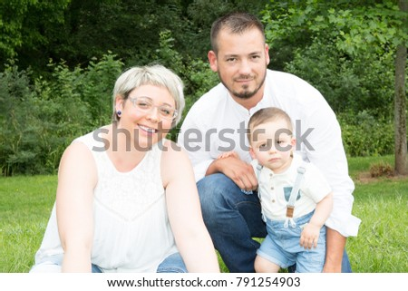 Portrait Of Happy Family In the summer park #791254903