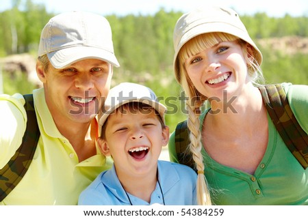 Portrait of happy family looking at camera