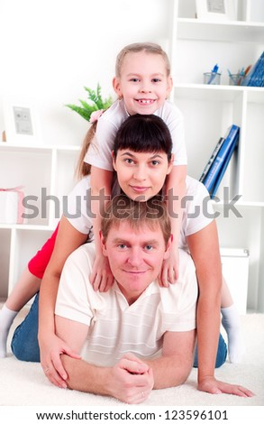 Portrait of happy family lying together, hugging and happy