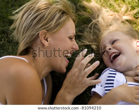 portrait of happy family mother with daughter in garden