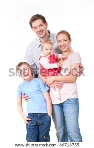 Portrait of happy family of four persons on a white background