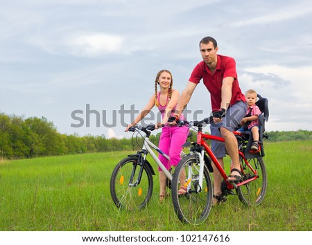 Portrait of happy family on bicycles at your leisure