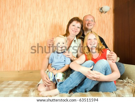 Portrait of happy family relaxing together indoor