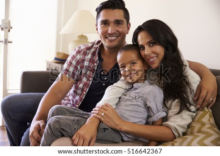 Portrait Of Happy Family Sitting On Sofa In at Home #516642367