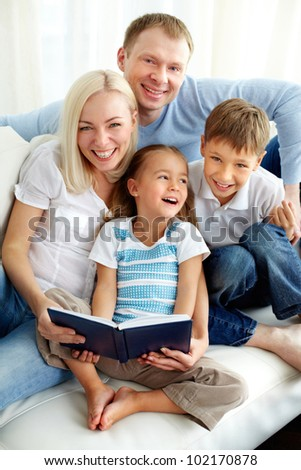 Portrait of happy family with two children looking at camera